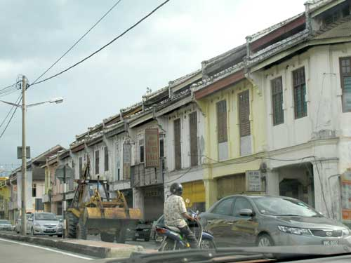 RELICS: Shophouses of a bygone era lining the main street.