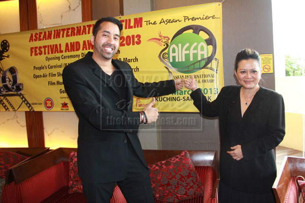 EXCITING FILM FEST: Kamil (left) and Livan giving their thumbs up to the Asean film festival.