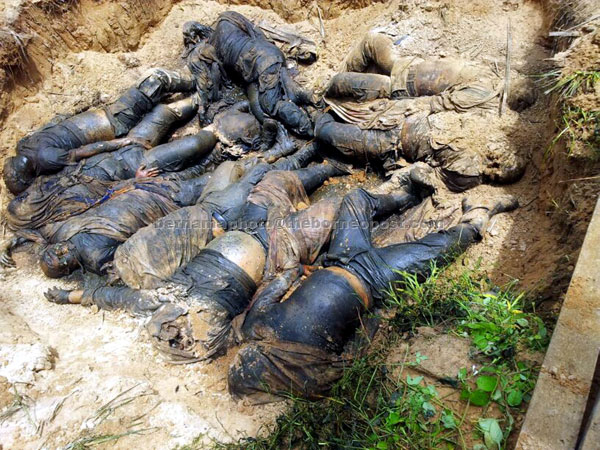 GRUESOME FIND: The bodies of nine intruders found by Malaysian security forces during a mopping up and search operation under 'Ops Daulat' in Kampung Tanduo yesterday. — Bernama photo