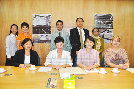 ALL SET: Dr Sue (seated second left) together with McClymont (seated far right), Lau (seated second right) and the team from Woodlands International School at the press conference.