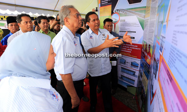 Aidel (right) briefs Adenan on the plan for the proposed Sadong Jaya Community Sports Complex costing RM3 million.