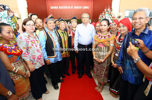 Adenan (sixth right) together with (from fourth left) Ranum, Nansian, Dr Jerip and others during his arrival at the Lundu District Community Hall. — Photos by Muhammad Rais Sanusi