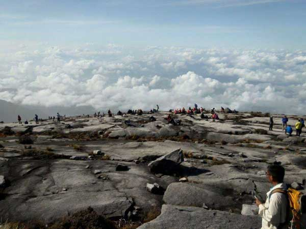 Waiting for instruction to descend at mount Kinabalu summit.