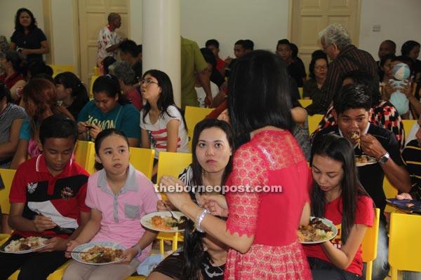 Visitors enjoying the food.