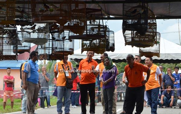 Abdul Karim (third left) appreciating the singing birds kept inside the cages.