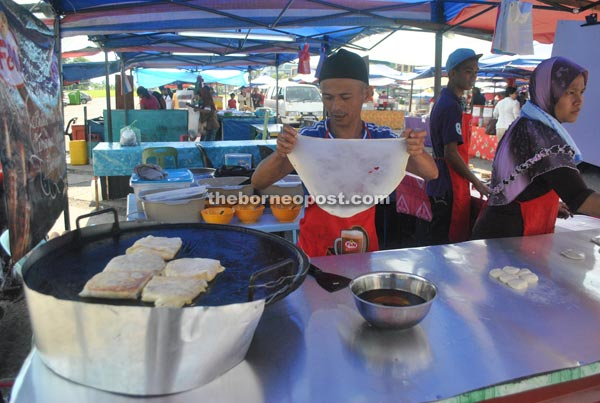 Ibrahim busy making roti canai.