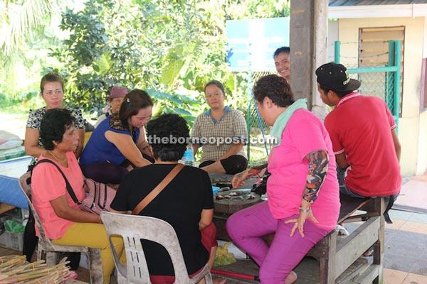 Womenfolk at Selangau having a 'ngiling bidai', the closing of Gawai.