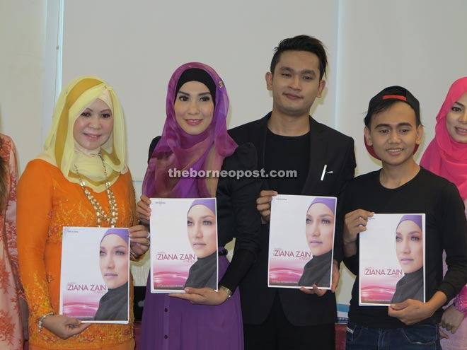 Lisdawati (second left) display the 'Aidilfitri with Ziana Zain & Friends' event poster alongside (from left) Juita, Syafrie and Fizree.