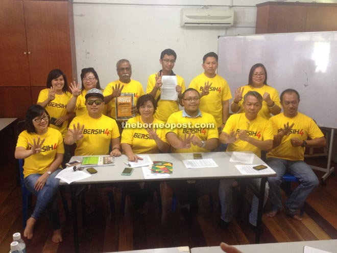 Jannie (seated third left), Wong Tack (seated second right) and other members of the Bersih4 Sabah committee yesterday.