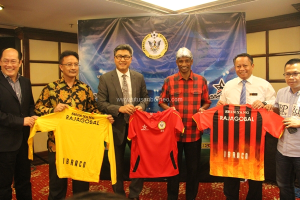 Captain Sudarsono hands a Sarawak team shirt to Ragajopal symbolically announcing his appointment as the Crocs new head coach.