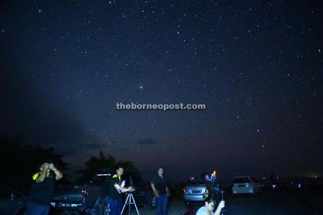 Photographers star gazing with their DSLR.