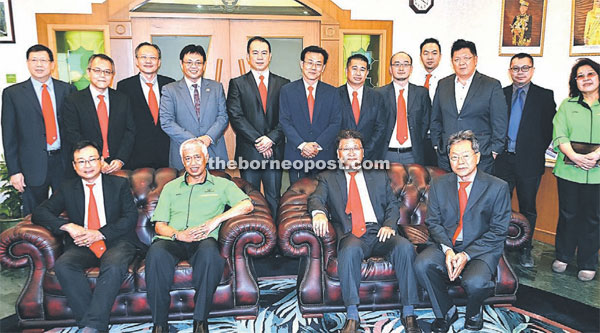 (Seated left to right) Sim, Abdul Wahap, Ngui, Tan, DBKU director Dr Saadiah Abdul Samat (standing far right) as well as Sheda Kuching branch members had a photo session before the meeting yesterday.