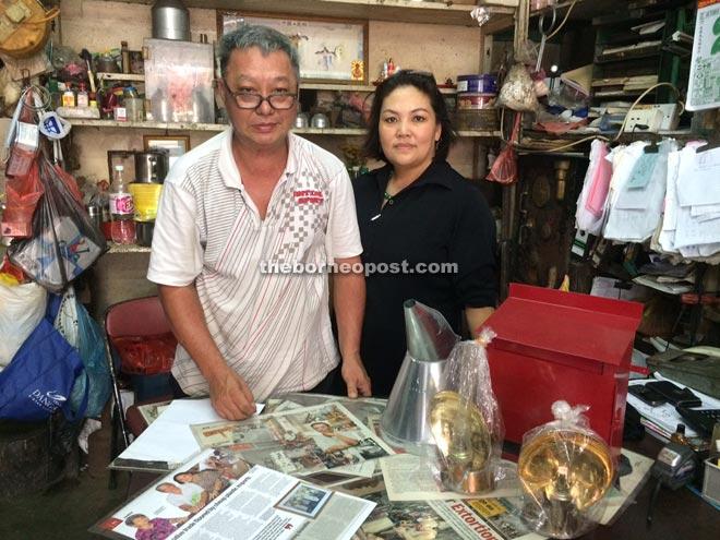 Tinsmith Ho Chin Hin and wife Chan Gek Kiak at their shop.