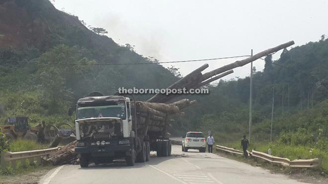 Lorry hantu drivers often overload their heavy vehicles with huge and long logs.
