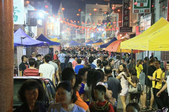 People throng Carpenter Street nightly during the Kuching Inter-Cultural Mooncake Festival 2015.