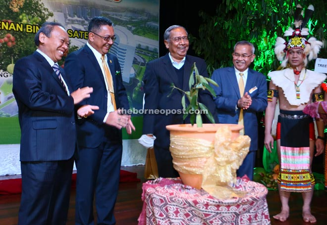 Adenan (centre) sharing  a light moment after planting the `tree of integrity' during SEDC's Integrity Day 2015. With him are (from left) Nansian, Soedirman and Talib.