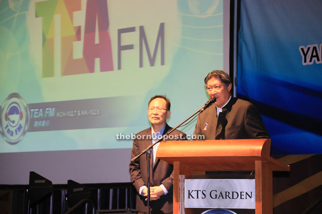 Lau (left) and Siew on stage to introduce Tea FM to the guests.