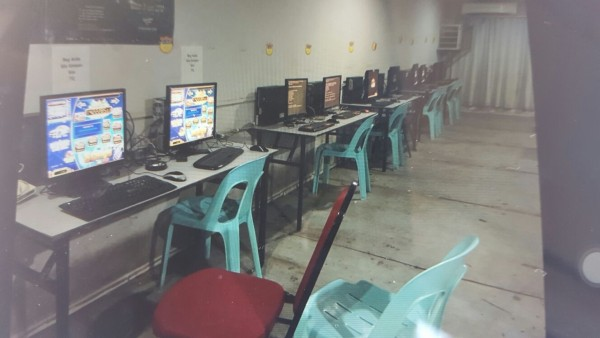 Computers are seen at the raided premises in Senadin, Miri. - Photo courtesy of state CID