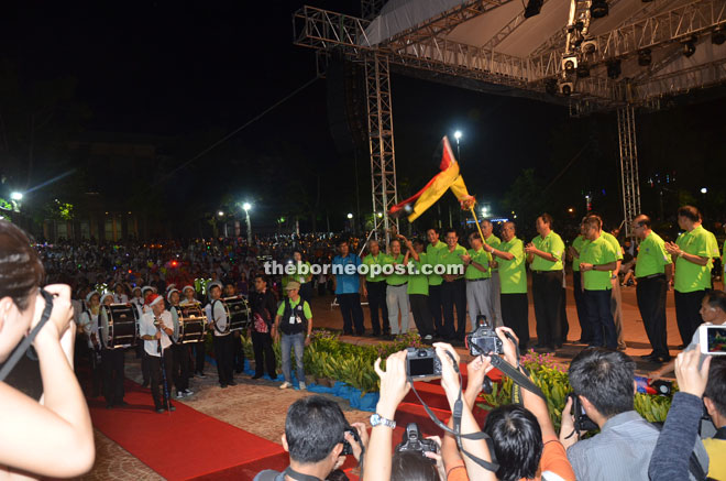 Adenan flags off the parade at Miri City Fan.