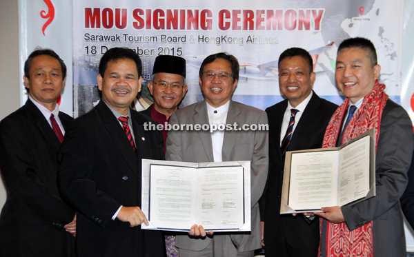 Abang Johari (third right) joins (from right) Zhang, Liu, Talib and Ik Pahon for a photo-call after the signing.