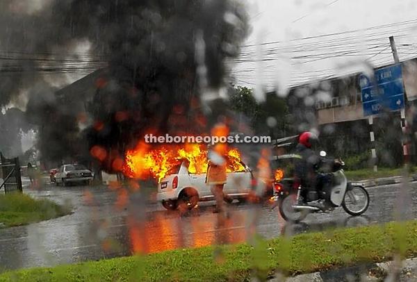An alarming sight of the Perodua Kelisa on fire.
