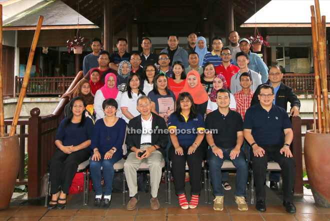 Dris (front, third left) in a photo-call with the Greater Azam management and staff as well as retreat facilitators.