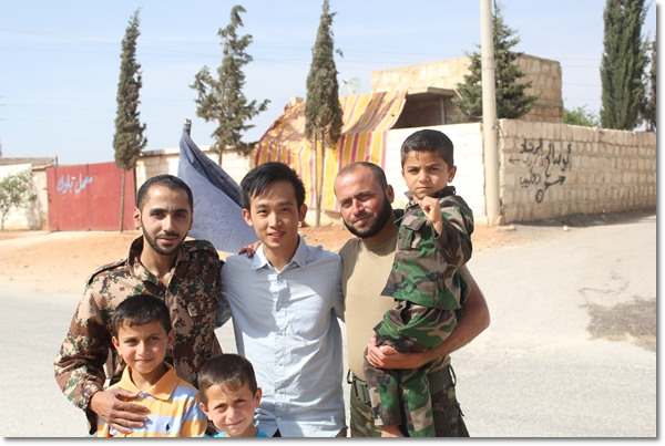 In Syria with some opposition fighters and their kids.