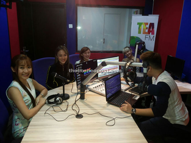 The girls are being interviewed at Tea FM.