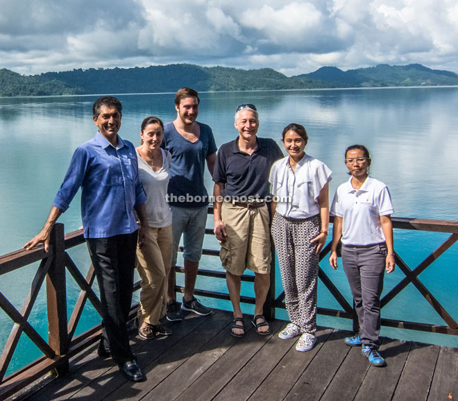 (From second left) Eva-Maria, Simon Jr and Aicher with some resort staff.