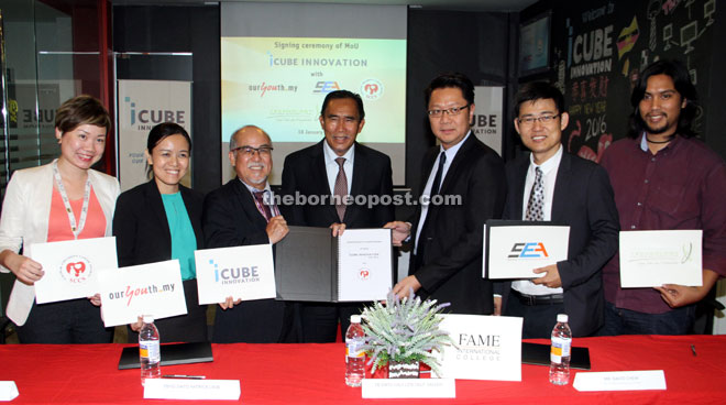 Len (centre) witnessing the MOU which was signed by Liew (third left) and the representatives from FAME International College executive officer David Chew (third right), Technology College Sarawak corporate affairs director Amin Aznizan (right), OurYouth.my operations manager Patsda Liew (second left), Sarawak Children's Cancer Society manger Jodie Sim (left) and Sarawak Entrepreneurs Association president Simon Wong (second right). — Photo by Chimon Upon