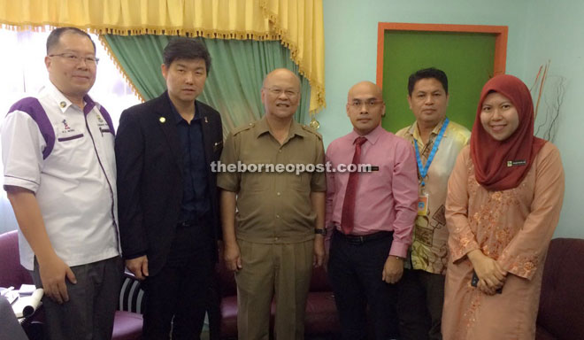 Minos (third left) in his office with senior personnel from SDC and Fama.