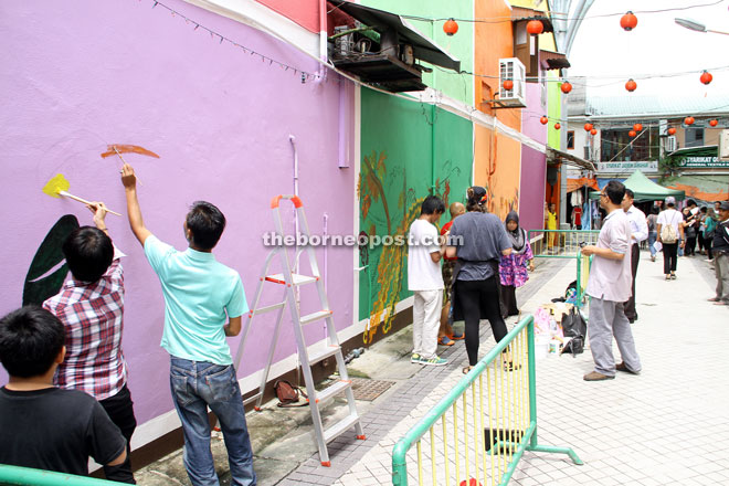 Some members of the public take the opportunity to join in the fun at Kai Joo Lane.