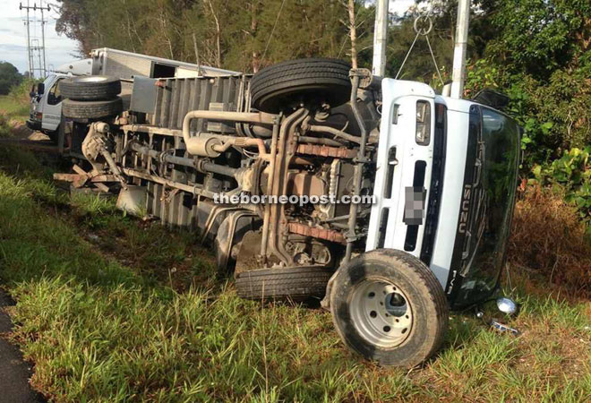 The lorry landed on its side after avoiding an oncoming car.