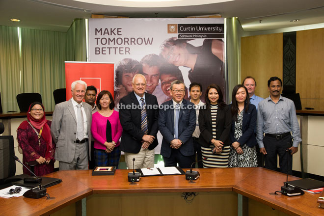Representatives of Curtin Sarawak and AICB pose for a group photo.