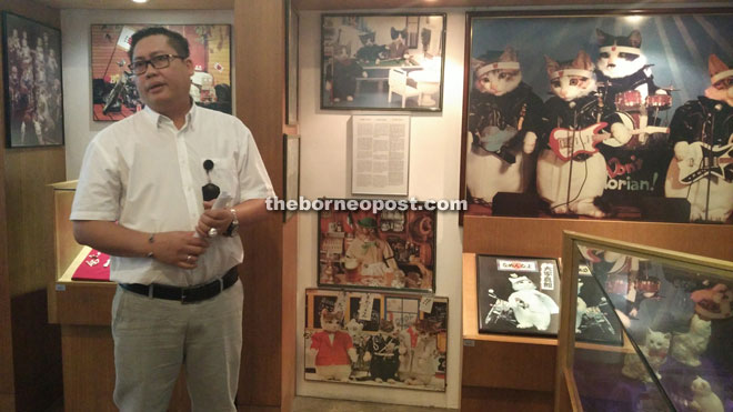 Unit head of DBKU's Cat Museum Bahtiar Affendi takes reporters on a tour around Gallery C.