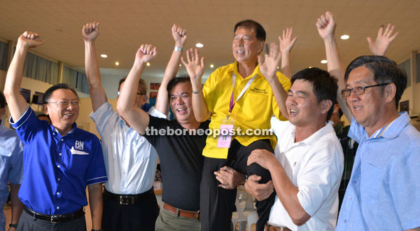Ting being cheered by fellow comrades after the result was announced.