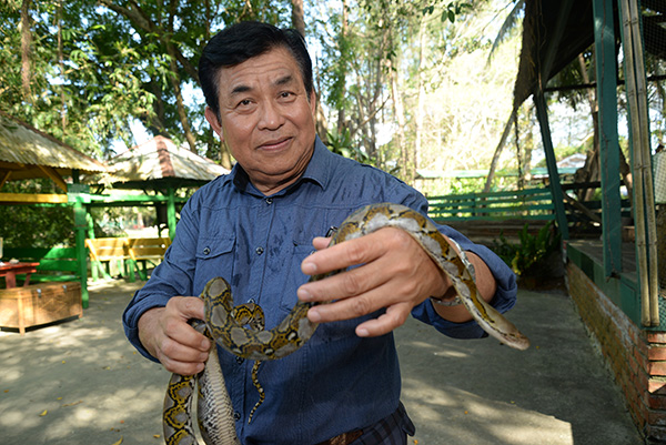 Chai holding the python which the public too can handle.