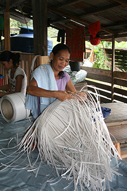 One of the Penan ladies taking part in the weaving project.