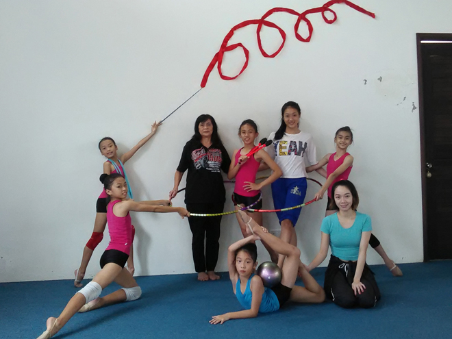 Sarawak are fielding five gymnasts for Sukma XVIII. They are pictured with Helena (second left, standing), Shaleen (squatting) and Fiona (second right, standing) during a training session at the training centre at Queen's Court.
