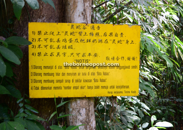 When visiting Batu Nabau, one must remember to abide by the instructions stated on this signboard.
