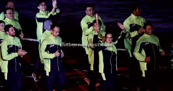 Tania Bugo and Watson Nyambek on the way to put the baton on a plaque at the centre stage.