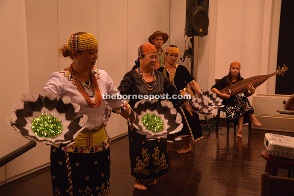 (From left) Nancy, Jennette and Rigo perform a cultural dance to the melodic sound of sape.