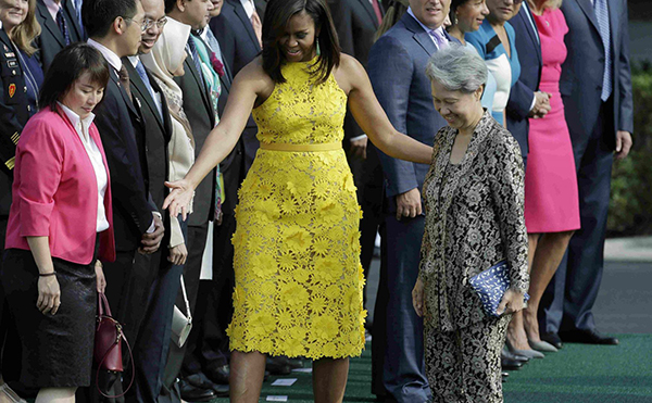 Mdm Ho Ching and her dino pouch with America First Lady.