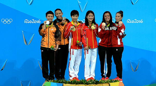 (From left) Malaysia's Olympic silver medallists Cheong Jun Hong and Pandelela Rinong Pamg are seen with gold medallists Chen Ruolin and Liu Huixia from China as well as bronze medallists from Canada Meaghan Benfeito and Roseline Filion on the podium for the women's synchronised diving 10-metre platform. — File photo