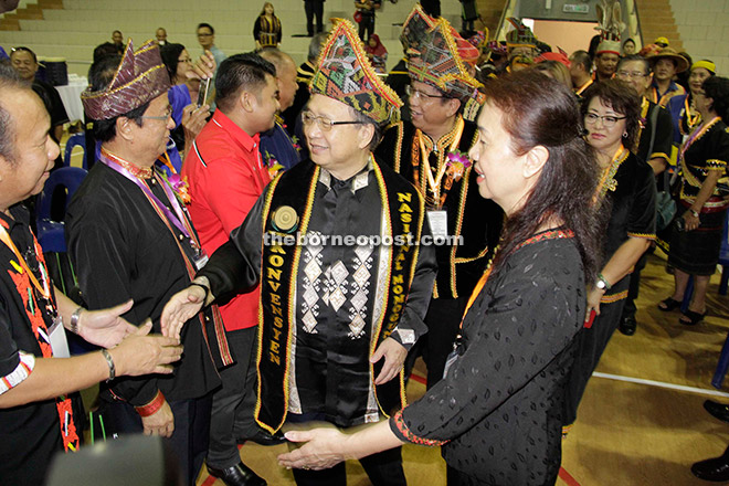 Dompok being greeted by delegates on his arrival at the convention venue.