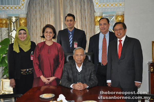 Adenan (seated) in a photo call with (from left) Aziza, Aireen, Muhammad Yusran, Zamani and Abang Johari.