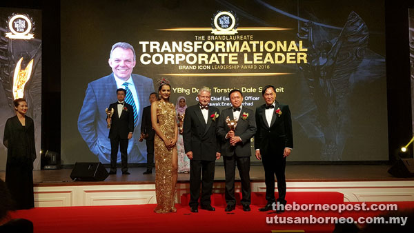 Lau Kim Swee, CEO of Sesco receiving the 'Most Sustainable Brand' award on behalf of Datuk Torstein Dale Sjotveit from Chairman of the Asia Pacific Brands Foundation Tan Sri Rainer Althoff (second left) and President of the BrandLaureate Dr KK Johan (right) at the The BrandLaureate Awards.