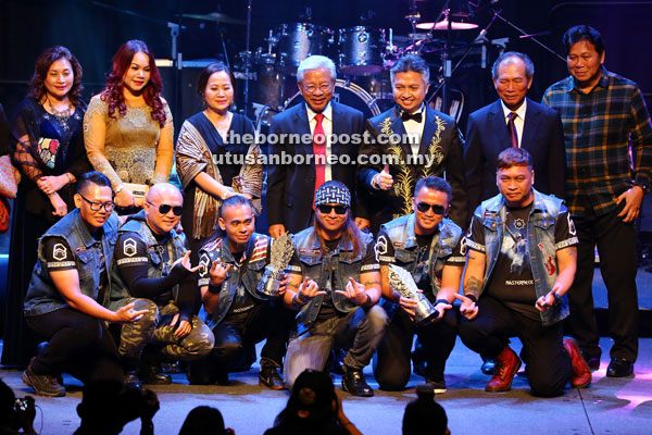 Masing (standing, centre) with members of Masterpiece (front row) after the presentation of the awards. With Masing are (standing, from right) Mussen, Salang and Snowdan. — Photos by Muhammad Rais Sanusi