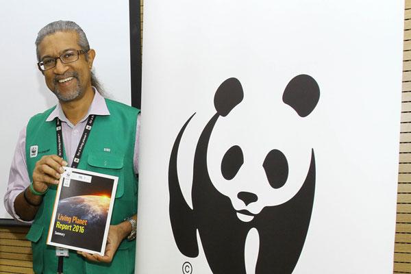 Sharma shows the Living Planet Report 2016.