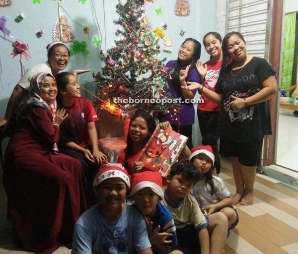nur ainaa with head scarf is excited to celebrate christmas with her family especially